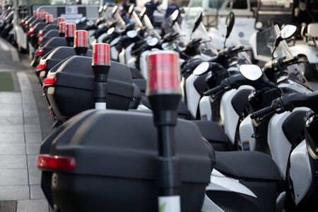 Selected focus A row of parked Police motorcycles  with red lamp for security