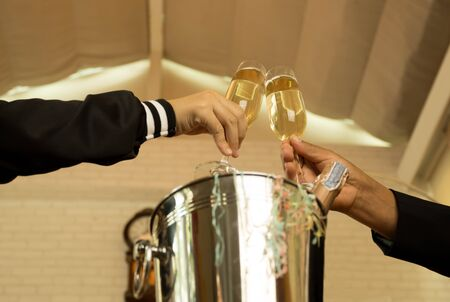 Celebration hand  holding glasses of champagne making a toast