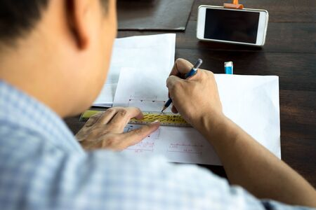architect tools: Interior designer works on a hand sketch using pencils and rule on the desk Stock Photo
