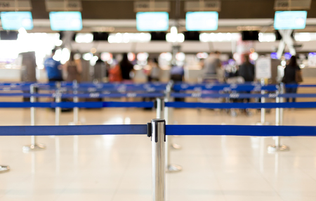 Waiting lines in the airport and security post for passenger check in Imagens