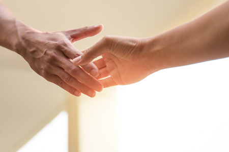 give out: Help Concept Hands reaching out to help together in with sunlight