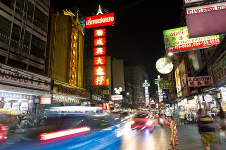 streetlife: CHINATOWN, BANGKOK, THAILAND - Apr 27, 2017: At China Town bangkok cars light trail and shops and a lot off people at night time