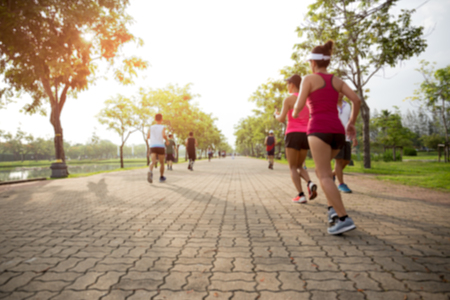 Blurred concept group of people running in the park in the morning 스톡 콘텐츠