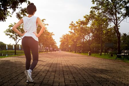 Healthy care concept lifestyle woman jogging in the park in he morning