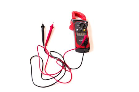 Electrician meter instrument and wires with digital multimeter isolated in white background