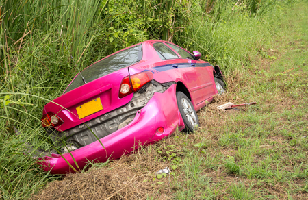 Road accident car crash on the side of the road into the bush in Thailand