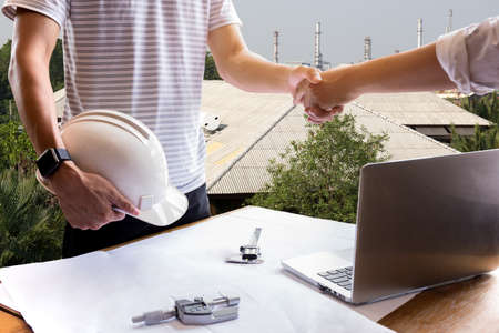 construction project: Business hand shake engineer construction shaking hand successful agreement project Solar power