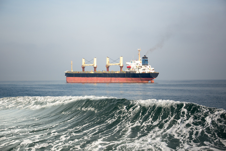 Oil and gas tanker ship in the sea with wave