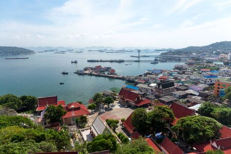 Village on the island with oil and gas shipping in Gulf of Thailand