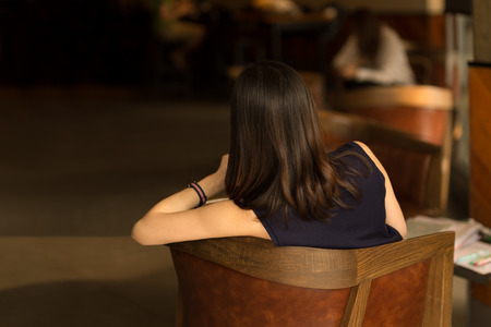 Back view of the business woman with beautiful hair sitting on chair Stok Fotoğraf