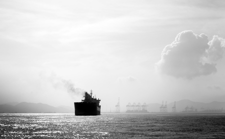 Oil and gas tanker ship in the ocean in black and white