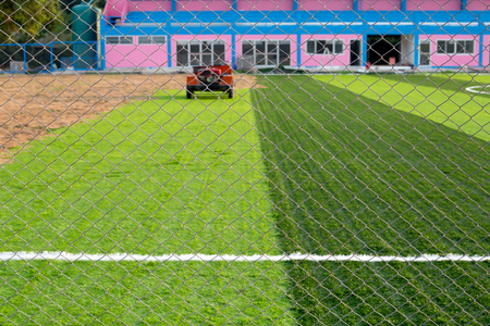 Wire mesh fence from new soccer field in the public areas in country