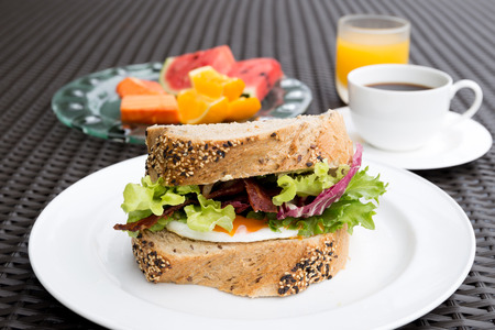 Breakfast set with fried eggs sandwich and coffee and orange juice in the morning Stock Photo