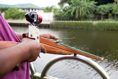 Man preparing speargun for Spearfishing on the river Stock Photo