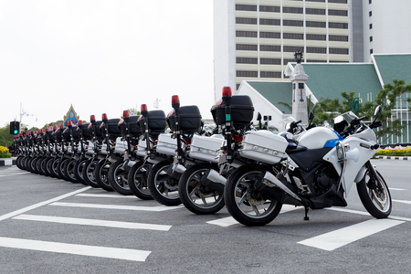 Police officers  motorcycle line up on the road in Thailand