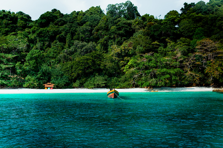 Conceptual cinematic color of the beach and long tail boat in Flower Island in Thailand