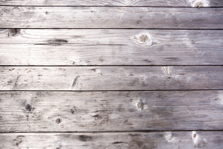Grey wooden table surface texture and background.