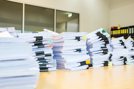 Pile of unfinished documents on office desk. 免版税图像