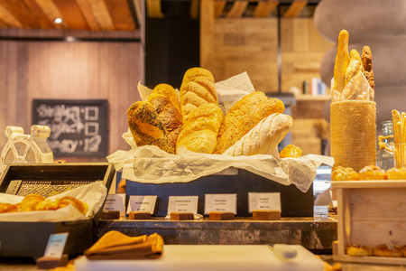 Modern bread counter with large fresh bakery products.