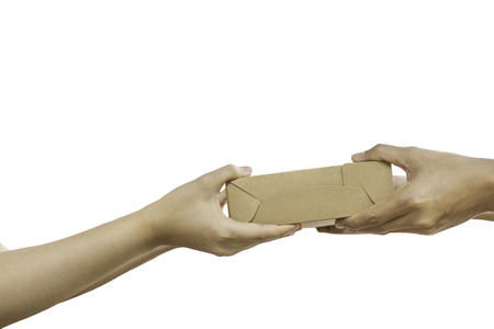 Hand giving package parcel isolated in clipping path.
