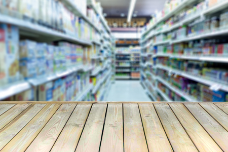 Wooden board with empty table blurred shopping mall