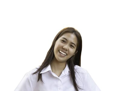 Teenage woman with perfect smile looking at camera in clipping path. Stock Photo