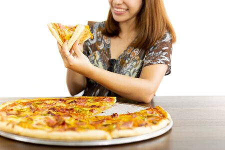 Happy woman holding pizza slices in hands isolated in white background
