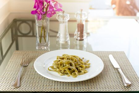 Spinach fettuccine Noodles cook with garlic and olive oil health care concept.