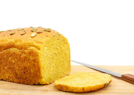 Homamade whole wheat bread loaf with pumkin seeds in white background. Stock Photo