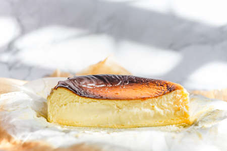 Homemade of basque burnt cheesecake on paking paper.