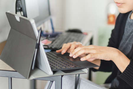 Businesswoman hands typing on laptop keyboard making at home.
