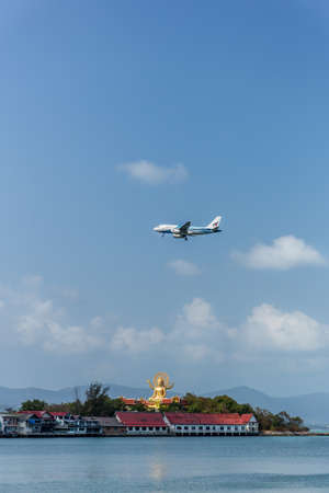 Koh Samui Island in Thailand - 20 Feb 2021 : Bangkok airways passenger plane landing over big buddha.