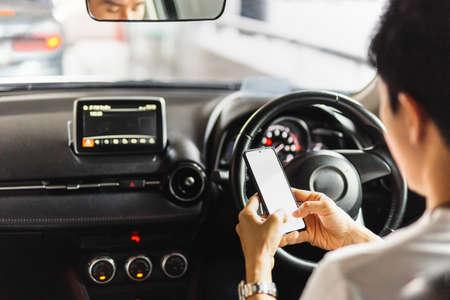 Irresponsible man using smart phone while driving.
