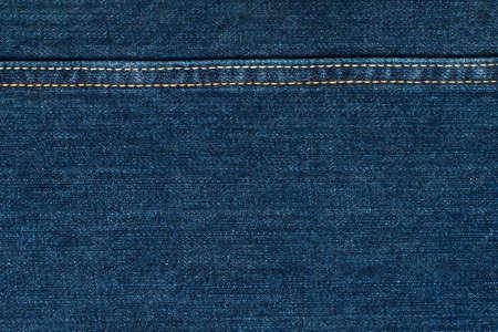 Blue Jeans Cloth With Seam. Background Texture. Standard-Bild