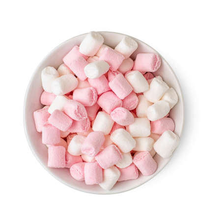 White and rose Fluffy marshmallows in bowl isolated on white background. Top view.