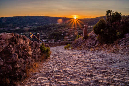 Sunset over a stone path in Moustiers Sainte Marie