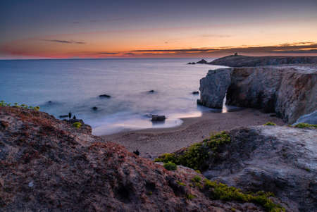 The arch of Port Blanc at sunset in Quiberon Stock Photo
