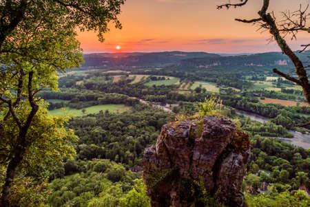 Dordogne river taken from the cliffs above Mezels in Dordogne valley at sunset