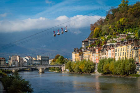 Cable cars in Grenoble in autumn with a nice sunset light Editoriali