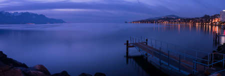 Pier in Montreux just after sunset with a blue light in the winter Stock Photo