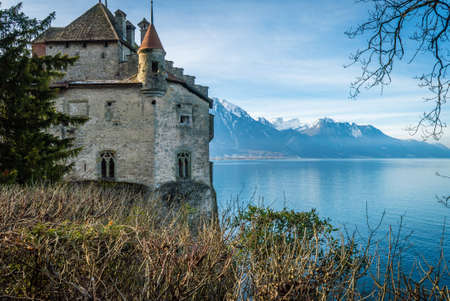 Chillon castle view from the top and Geneva lake in the background Editorial