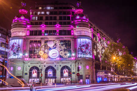 Printemps shopping galleries with Christmas decorations at night Editorial