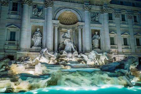 Trevi fountain in Rome by night with lights on Stock Photo