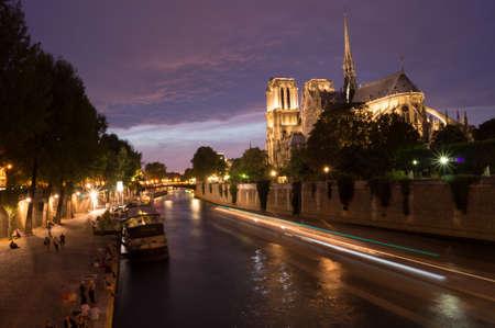 Peniche boats passing by Notre Dame de Paris cathedral