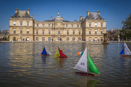 Toy boats in the Senat fountain in Paris