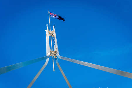 Australian flag flying on top of the Parliament House in Canberra