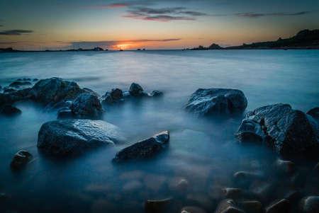 Sunset over Primel harbour in Bretagne in France, long exposure