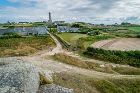 Batz island lighthouse and houses in Bretagne in the summer