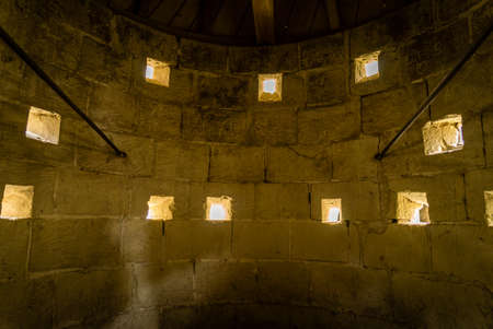 Loopholes in an old medieval shooting tower in France