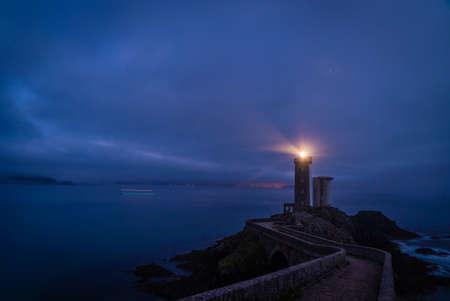 Petit minou lighthouse at night with light beam shining